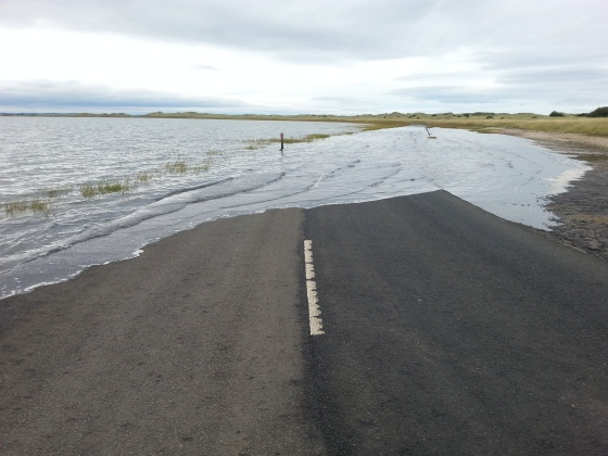 The road leaving the Holy Island of Lindisfarne, Northumberland, flooded at high tide.